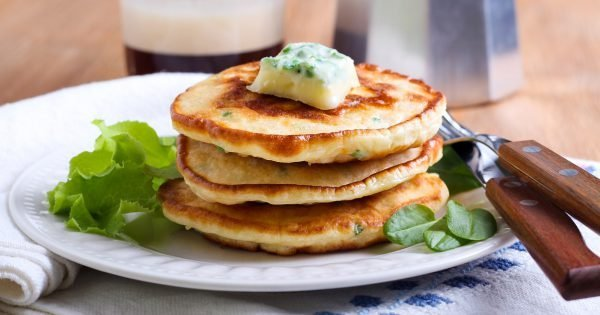 Sweetcorn pancakes with herb butter on plate