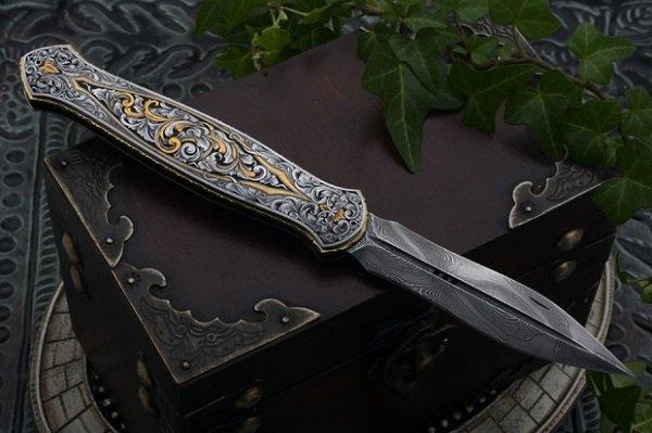 нож с резьбой на рукоятке