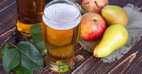 Glass and bottles of cider