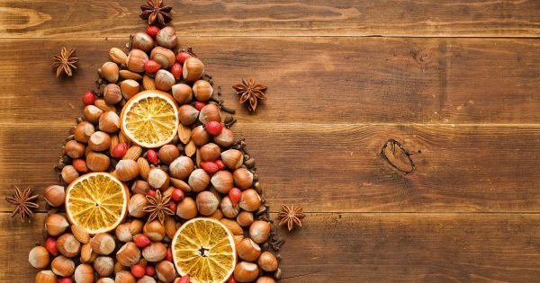 Christmas tree made of nuts, spices and dried oranges. Viewed from above.