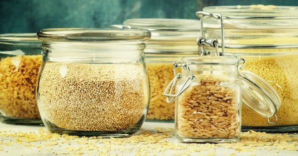 Assorted cereals and grains in glass jars for storage, selective focus