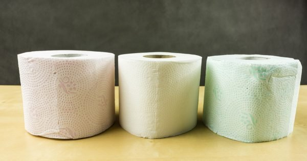 Three rolls of soft toilet paper in various colors (red, white, green)