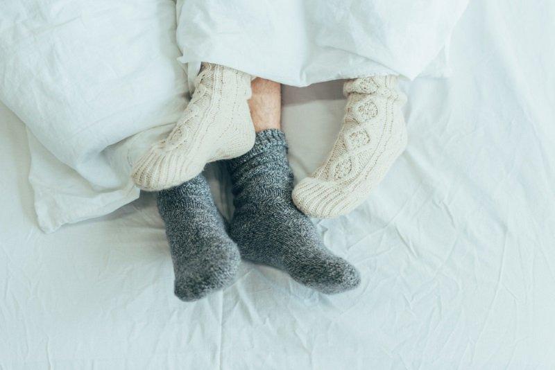 спать в носках полезно