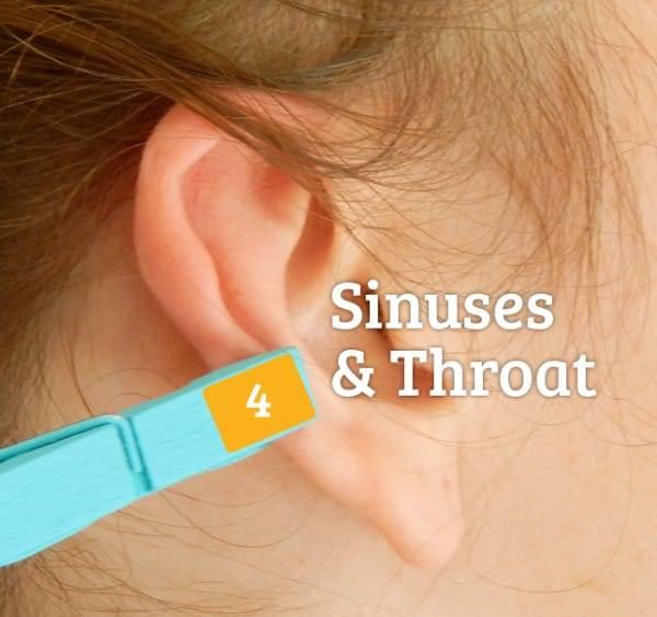 прищепка на ухе от боли