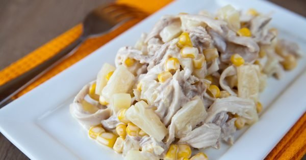 close-up fresh salad with chicken, pineapple and corn