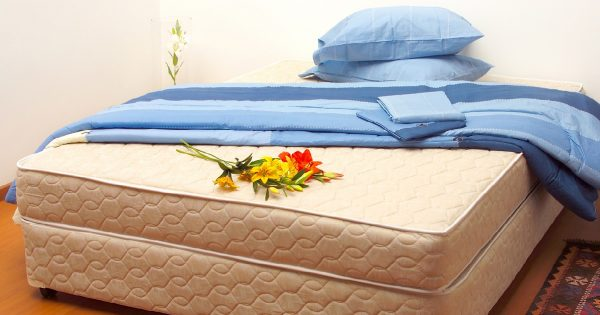Mattress with sheets and pillows