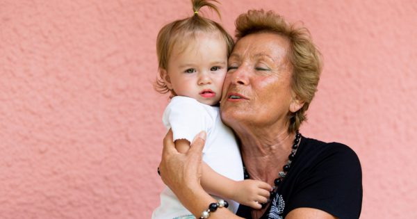 Grandmother loves her grandkid while showing her true feelings.