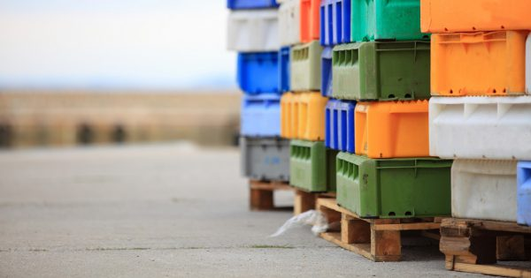colorful boxes plastic crates. Packing containers piles for fish storage of catch.