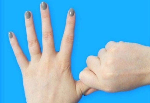 массирование большого пальца
